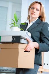 Emotional Side of Job Loss - not so happy woman with desk stuff in box